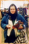 Woman selling chicken an egg